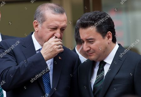 Turkish President Recep Tayyip Erdogan Chat with Deputy Prime Misinter of Turkey Ali Babacan During the Opening Ceremony of the Ziraat Katilim Bank (participation Bank) in Istanbul Turkey 29 May 2015 Turkey Istanbul
