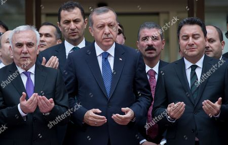 Turkish President Recep Tayyip Erdogan (c) Deputy Prime Misinter of Turkey Ali Babacan (r) and General Manager of Ziraat Katilim Bank Huseyin Aydin Pray During the Opening Ceremony of the Ziraat Katilim Bank (participation Bank) in Istanbul Turkey 29 May 2015 Turkey Istanbul