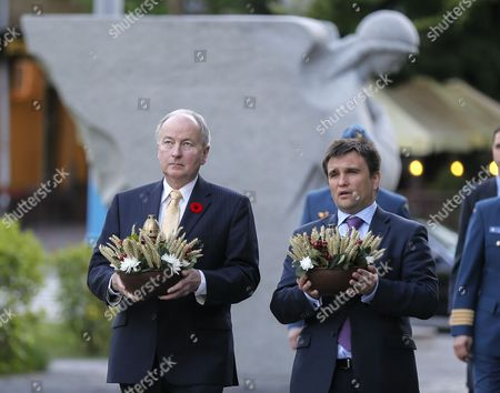 Stock Photo of Ukrainian Foreign Minister Pavlo Klimkin (r) and His Canadian Counterpart Rob Nicholson (l) Lay Flowers to the Monument For the Victims of the Great Famine (holodomor) in 1932-1933 in Kiev Ukraine 11 May 2015 the Holodomor was a Man-made Famine Provoked by Soviet Dictator Josef Stalin the Result was the Death to More Than Five Million Ukrainians Rob Nicholson Arrived in Ukraine at May 11 For Two-day Official Visit Ukraine Kiev