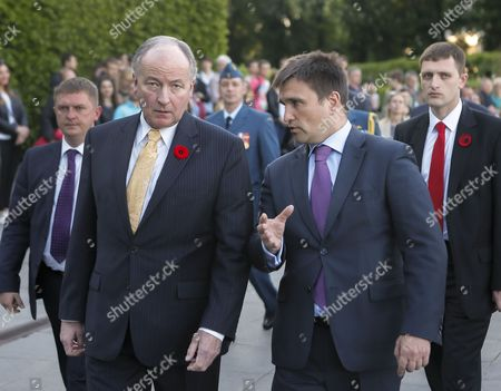Stock Picture of Ukrainian Foreign Minister Pavlo Klimkin (r) Speaks with His Canadian Counterpart Rob Nicholson (l) After a Flower Laying Ceremony at the Monument For Unknown Soldier in Kiev Ukraine 11 May 2015 Nicholson Arrived in Ukraine For a Two-day Official Visit Ukraine Kiev