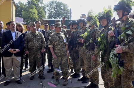 Stock Image of Canadian Defense Minister Jason Kenney (l) and His Ukrainian Counterpart Stepan Poltorak (2-l) Inspect the International Center of Peacekeeping and Security in Yavoriv Near the Western Ukrainian City of Lviv Ukraine 27 June 2015 Others Are not Identified Jason Kenney Arrived in Kiev on 25 June For a Three-day Visit to Ukraine to Hold Talk with President Petro Poroshenko Prime Minister Arseniy Yatsenyuk and Visit Military Facilities in the Lviv Region According to Ukrainian Media Ukraine Lviv