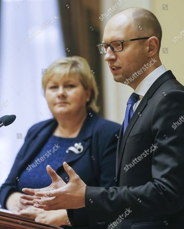Ukrainian Prime Minister Arseny Yatseniuk (r) is Watched by His Norwegian Counterpart Erna Solberg (l) As He Speaks During a Joint News Conference Following Their Meeting in Kiev Ukraine 18 November 2014 Erna Solberg Arrived in Ukraine For Discussing Bilateral Relations Energy Security Relations with Russia the Situation in Ukraine and Economic Contacts Ukraine Kiev