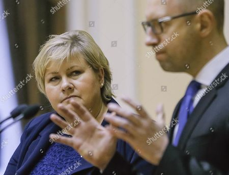 Stock Photo of Ukrainian Prime Minister Arseny Yatseniuk (r) is Watched by His Norwegian Counterpart Erna Solberg (l) As He Speaks During Their Meeting in Kiev Ukraine 18 November 2014 Erna Solberg Arrived in Ukraine For Discussing Bilateral Relations Energy Security Relations with Russia the Situation in Ukraine and Economic Contacts Ukraine Kiev
