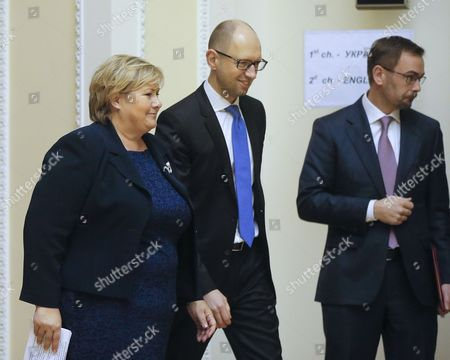Stock Picture of Ukrainian Prime Minister Arseny Yatseniuk (c) and His Norwegian Counterpart Erna Solberg (l) Speak During Their Meeting in Kiev Ukraine 18 November 2014 Man on Right is not Identified Erna Solberg Arrived in Ukraine to Discuss Bilateral Relations Energy Security Relations with Russia the Situation in Ukraine and Economic Contacts Ukraine Kiev