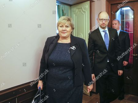 Ukrainian Prime Minister Arseny Yatseniuk (c) and His Norwegian Counterpart Erna Solberg (l) Arrive For Their Meeting in Kiev Ukraine 18 November 2014 Erna Solberg Arrived in Ukraine to Discuss Bilateral Relations Energy Security Relations with Russia the Situation in Ukraine and Economic Contacts Ukraine Kiev