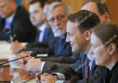 Polish Foreign Ministers Radoslaw Sikorski (2-r) Speaks During Meeting with His Ukrainian Counterpart Andrii Deshchytsia (not Pictured) in Kiev Ukraine 16 May 2014 Other Members of Soikorski's Delegation Are not Identified the Ministers Were Signing an Agreement on Cooperation Between Their Ministries For the Years 2014-2015 Which Includes Political Consultations of Representatives of the Weimar Triangle and the Visegrad Group Countries with the Ukrainian Authorities As Well As Regular Meetings of Polish and Ukrainian Foreign Ministers and Organizing Training Seminars For Ukrainian Diplomats Epa/sergey Dolzhenko Ukraine Kiev