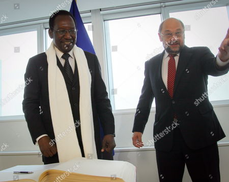 President of the European Parliament Martin Schulz (r) Welcomes President of Mali Dioncounda Traore After He Signed the Guestbook Prior to a Meeting at the European Parliament in Brussels Belgium 16 May 2013 Top Officials From Around the World on 15 May Exceeded Expectations with Combined Pledges of 3 25 Billion Euros (4 18 Billion Dollars) to Support Reconstruction in War-torn Mali Setting the Stage For Mali to Deliver Reforms in Return Belgium Brussels