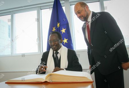 President of the European Parliament Martin Schulz (r) Welcomes President of Mali Dioncounda Traore who Signs the Guestbook Prior to a Meeting at the European Parliament in Brussels Belgium 16 May 2013 Top Officials From Around the World on 15 May Exceeded Expectations with Combined Pledges of 3 25 Billion Euros (4 18 Billion Dollars) to Support Reconstruction in War-torn Mali Setting the Stage For Mali to Deliver Reforms in Return Belgium Brussels