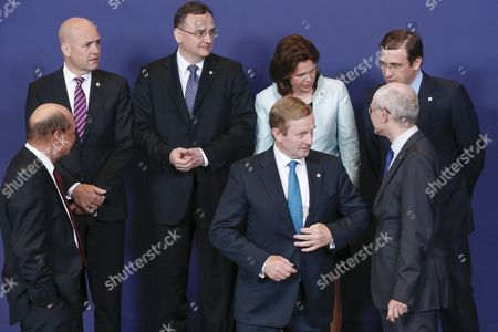 (l-r) Romanian President Traian Basescu Swedish Prime Minister Fredrik Reinfeldt Czech Prime Minister Petr Necas Irish Prime Minister Enda Kenny Slovenian Prime Minister Alenka Bratusek European Council President Herman Van Rompuy and Portuguese Prime Minister Pedro Passos Coelho Take Their Positions to Pose For the Traditional Group Photo During a European Council Summit in Brussels Belgium 27 June 2013 European Union Leaders Will Meet For a Two-day Summit Amid High Expectations For Progress on Everything From the Bloc's Economic Crisis to Its Enlargement But Also Scepticism That They Will Be Able to Cover Much Ground Belgium Brussels
