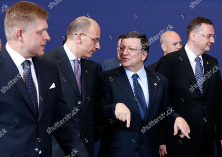 (l-r) Slovak Prime Minister Robert Fico Prime Minister of Italy Enrico European Commission President Jose Manuel Barroso and Czech Prime Minister Petr Necas Take Their Positions to Pose For the Traditional Group Photo During a European Council Summit in Brussels Belgium 27 June 2013 European Union Leaders Will Meet For a Two-day Summit Amid High Expectations For Progress on Everything From the Bloc's Economic Crisis to Its Enlargement But Also Scepticism That They Will Be Able to Cover Much Ground Belgium Brussels