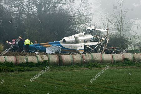 Police and Experts Seen Inspecting the Wreckage of a Helicopter at the Accident Site in Gillingham Norfolk Britain where a Civilian Helicopter Crashed Reportedly Killing All Four Occupants 14 March 2014 Lord Ballyedmond One of the Richest Men in Northern Ireland was Among Four People who Have Died in a Helicopter Crash Near the East Coast of England British Media Reported Friday the Agustawestland Aw139 Came Down in a Field Near the Village of Gillingham During Thick Fog Late Thursday Police Said the Victims Had not Yet Been Formally Identified and It was not Clear what Caused the Crash Ballyedmond Edward Haughey Before He was Created a Life Peer in 2004 was Chairman of Norbrook the Largest Privately Owned Pharmaceutical Company in the World He Had Served in Both the British and Irish Upper Houses of Parliament United Kingdom Gillingham