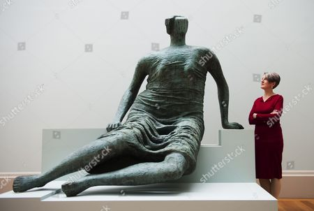 Penelope Curtis Director of Tate Britain Poses For Photographers Next to the Henry Moore Sculpture Draped Seated Figure During a Preview of the 'Walk Through British Art' Exhibition at the Tate Britain in London Britain 13 May 2013 a Collection of British Art Will Be Displayed in the Exhibition in a Chronological Order Starting From the 1500s to the Present Day the Exhibition Will Open to the Public From 14 May United Kingdom London