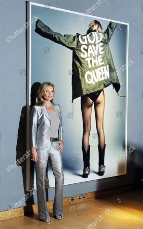 British Model Kate Moss Poses Next to an Artwork by British Photographer Craig Mcdean Entitled 'Kate Moss For I-d' During a Press View of an Auction of a Selection of Works Featuring Her at Christie's Auction House in London Britain 04 September 2013 the Sale 'Kate Moss From the Collection of Gert Elfering' Featuring Photographs Paintings Sculptures and Collages Among Others Will Take Place on 25 September United Kingdom London