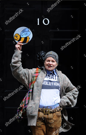 Fashion Designer Dame Vivienne Westwood Hands in a Petition to 10 Downing Street For Beekeepers Following a Demonstration in London Britain 26 April 2013 Over 100 Beekeepers Together with Designers Dame Vivienne Westwood and Katharine Hamnett Protested Outside Parliament Urging Secretary of State For Environment Owen Paterson to not Block the Eu Proposal to Suspend the Use of Bee Killing Pesticides the Demonstration Came Ahead of a Vote in Brussels Which Will Decide Whether Europe Agrees to Introduce a 2 Year Moratorium on the Use of Certain Types of Nenicotinoid Pesticides United Kingdom London