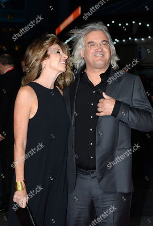 British Director Paul Greengrass and Joanna Greengrass (l) Arrive on the Red Carpet For the Movie Premiere of Captain Phillips During the 57th Bfi London Film Festival at Leicester Square in London Britain 09 October 2013 the Festival Runs From 09 Until 20 October United Kingdom London