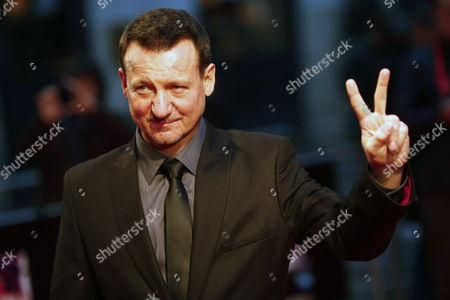 Polish Actor Robert Wieckiewicz Flashes the 'V' From Victory Sign to Journalists As He Arrives on the Red Carpet For the Premiere of Walesa Man of Hope During the 57th Bfi London Film Festival at Leicester Square in London Britain 11 October 2013 the Festival Runs From 09 Until 20 October United Kingdom London