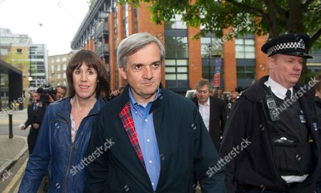 Former British Cabinet Minister Chris Huhne (c) Arrives at Home After Being Released From Prison with His Partner Carina Trimingham (l) in London Britain 13 May 2013 the Former British Cabinet Minister Chris Huhne and His Ex-wife Vicky Pryce an Economist Were Both Sentenced to Eight Months in Prison on 11 March 2013 After Being Convicted of Perverting the Course of Justice Over Offences Committed Over a Decade Ago when Vicky Pryce Took Speeding Points on Her License For Her Then Husband They Were Released After 62 Days of Their Respective Sentences United Kingdom London