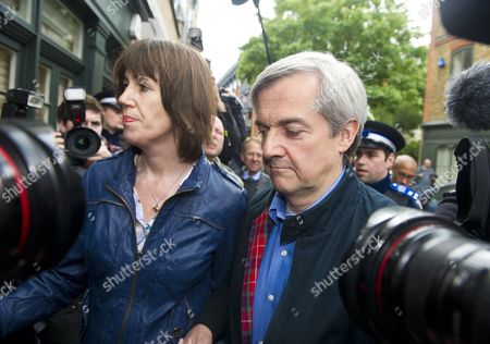 Stock Photo of Former British Cabinet Minister Chris Huhne (r) Arrives at Home After Being Released From Prison with His Partner Carina Trimingham (l) in London Britain 13 May 2013 the Former British Cabinet Minister Chris Huhne and His Ex-wife Vicky Pryce an Economist Were Both Sentenced to Eight Months in Prison on 11 March 2013 After Being Convicted of Perverting the Course of Justice Over Offences Committed Over a Decade Ago when Vicky Pryce Took Speeding Points on Her License For Her Then Husband They Were Released After 62 Days of Their Respective Sentences United Kingdom London
