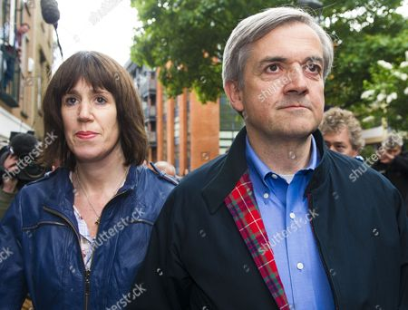 Former British Cabinet Minister Chris Huhne (r) Arrives at Home After Being Released From Prison with His Partner Carina Trimingham (l) in London Britain 13 May 2013 the Former British Cabinet Minister Chris Huhne and His Ex-wife Vicky Pryce an Economist Were Both Sentenced to Eight Months in Prison on 11 March 2013 After Being Convicted of Perverting the Course of Justice Over Offences Committed Over a Decade Ago when Vicky Pryce Took Speeding Points on Her License For Her Then Husband They Were Released After 62 Days of Their Respective Sentences United Kingdom London
