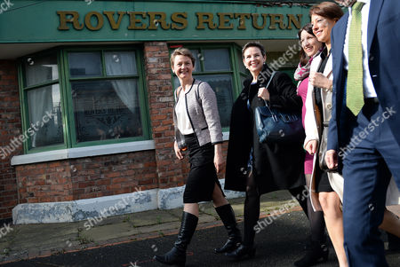 Members of the Labour Shadow Cabinet Yvette Cooper (l-r Shadow Home Secretary) Mary Creagh (shadow Secretary of State For International Development) Rachel Reeves (shadow Secretary of State For Work and Pensions) Lucy Powell (mp For Manchester Central and Vice-chair of the General Election Campaign) and Douglas Alexander (shadow Foreign Secretary) Walk Past the Rovers Return Inn the Old Coronation Street Set Ahead of Labour Party Leader Ed Miliband's Speech at His Party's Manifesto in Manchester Britain 13 April 2015 Britain Heads to the Polls in the General Election Slated For 07 May 2015 United Kingdom Manchester