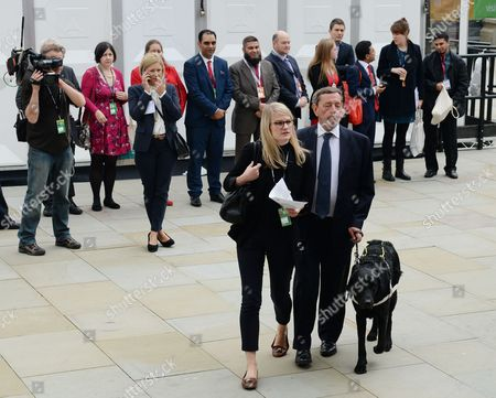 Former Home Secretary in the Last Labour Government in the Uk David Blunkett (c-r) Arrives with His Guide Dog to the Opposition British Labour Party's Annual Conference in Manchester North West England 23 September 2014 United Kingdom Manchester