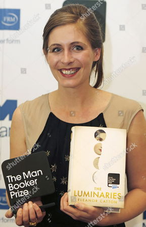 New Zealand Novelist Eleanor Catton Poses with Her Book 'The Luminaries' As Winner of the 2013 Man Booker Prize After the Announcement Held at Guildhall London Britain 15 October 2013 the Man Booker Prize is Britain's Most Coveted Literary Recognition and is Awarded Each Year For the Best Original Full-length Novel Written in the English Language by a Citizen of the Commonwealth of Nations Or Ireland United Kingdom London