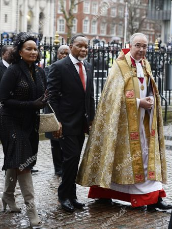South African Deputy President Kgalema Motlanthe (c) Arrives with His Partner Gugu Mtshali (l) and Dean of Westminster Reverend John Hall (r) For a Memorial Service to Celebrate the Life of Former South Africa President Nelson Mandela in Westminster Abbey in London Britain 03 March 2014 Nobel Peace Prize Winner Nelson Mandela Died at the Age of 95 on 05 December 2013 United Kingdom London