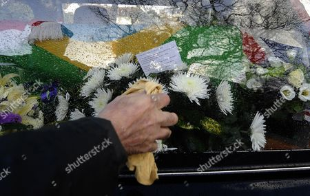 The Window of the Hearse of Train Robber Ronnie Biggs is Wiped at His Funeral on Arrival at Golders Green Crematorium in North London Britain 03 January 2014 Ronnie Biggs a British Petty Criminal who Became Infamous For His Role in the Great Train Robbery of 1963 and His Subsequent Life on the Run Had Died Aged 84 at a Care Home in London on 18 December 2013 Biggs was Part of a Gang That Held Up a Royal Mail Train Making Off with 2 6 Million Pounds Biggs Received a 30-year Jail Sentence in 1964 But Escaped After Havng Served Just 15 Months He Then Used His Share of the Money to Undergo Elaborate Plastic Surgery in Paris Before Travelling on to Australia It was the Beginning of 35 Years on the Run Most of Which Were Spent in Rio De Janeiro United Kingdom Leatherhead