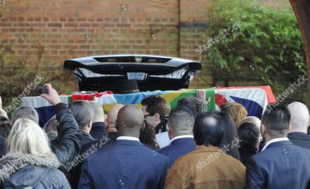 Mourners Carry the Coffin of Great Train Robber Ronnie Biggs Inside Golders Green Crematorium in London Britain 03 January 2014 Britain's Great Train Robber Ronnie Biggs Has Died Aged 84 at a Care Home in London on 18 December Biggs Won Notoriety For His Role in Holding Up a Royal Mail Train in 1963 Before Eventually Fleeing to Rio De Janeiro and Spending 35 Years on the Run United Kingdom London