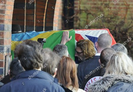 Nick Reynolds Son of Great Train Robber Bruce Reynolds Carries the Coffin of the Coffin of the Great Train Robber Ronnie Biggs Inside Golders Green Crematorium in London Britain 03 January 2014 Ronnie Biggs a British Petty Criminal who Became Infamous For His Role in the Great Train Robbery of 1963 and His Subsequent Life on the Run Had Died Aged 84 at a Care Home in London on 18 December 2013 Biggs was Part of a Gang That Held Up a Royal Mail Train Making Off with 2 6 Million Pounds Biggs Received a 30-year Jail Sentence in 1964 But Escaped After Havng Served Just 15 Months He Then Used His Share of the Money to Undergo Elaborate Plastic Surgery in Paris Before Travelling on to Australia It was the Beginning of 35 Years on the Run Most of Which Were Spent in Rio De Janeiro United Kingdom London