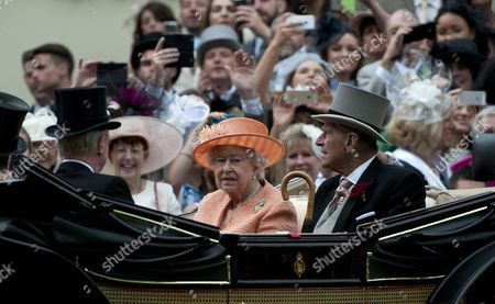 Britain's Queen Elizabeth Ii (c) and Prince Philip Duke of Edinburgh (r) Arrive in a Horse-drawn Carriage on the Fourth Day of Royal Ascot Near London Britain 20 June 2015 This Marks the Final Day of the Annual Horse Racing Meeting Epa/will Oliver United Kingdom London