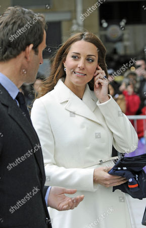 Stock Image of Catherine Duchess of Cambridge (r) Accompanied by British Competitive Sailor Sir Charles Benedict Ainslie (l) Leaves the Spinnaker Tower in Portsmouth Britain 12 February 2015 the British Royal Visited the Planning of the America's Cup World Series with Multigold Medal Winner Ben Ainslie United Kingdom Portsmouth