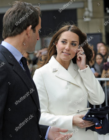 Stock Photo of Catherine Duchess of Cambridge (r) Accompanied by British Competitive Sailor Sir Charles Benedict Ainslie (l) Leaves the Spinnaker Tower in Portsmouth Britain 12 February 2015 the British Royal Visited the Planning of the America's Cup World Series with Multigold Medal Winner Ben Ainslie United Kingdom Portsmouth