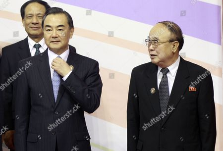 Stock Image of North Korea's Foreign Minister Pak Ui Chun (r) and China's Foreign Minister Wang Yi (l) Start to Pose For a Group Photo at the 20th Asean - Regional Forum (arf) at International Convention Center in Bandar Seri Begawan Brunei Darussalam 02 July 2013 Brunei is the Host Country of the 20th Association of Southeast Asian Nations (asean) Regional Forum (arf) Brunei Darussalam Bandar Seri Begawan