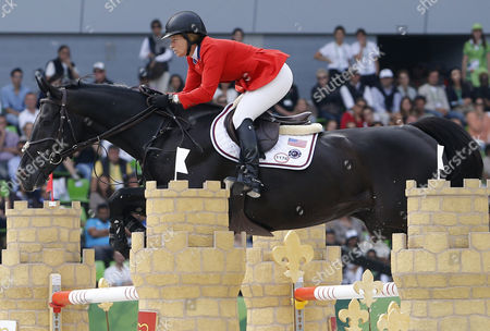 Us Rider Beezie Madden on Horse Cortes 'C' Clears an Obstacle During the Jumping Competition at the World Equestrian Games 2014 in Caen France 06 September 2014 France Caen