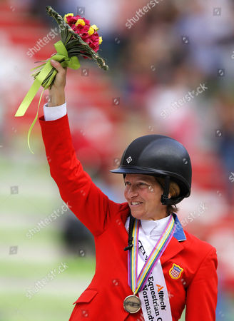 Us Rider Beezie Madden Celebrates on the Podium After Winning the Bronze Medal in the Jumping Final Four Competition at the World Equestrian Games 2014 in Caen France 07 September 2014 France Caen