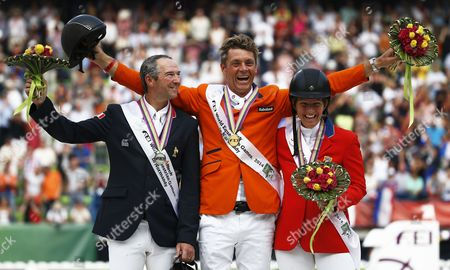 Dutch Rider Jeroen Dubbeldam (c) Celebrates on the Podium After Winning the Gold Medal in the Jumping Final Four Competition at the World Equestrian Games 2014 in Caen France 07 September 2014 Dubbeldam Won Ahead of Second Placed French Rider Patrice Delaveau (l) and Third Placed Us Rider Beezie Madden (r) France Caen