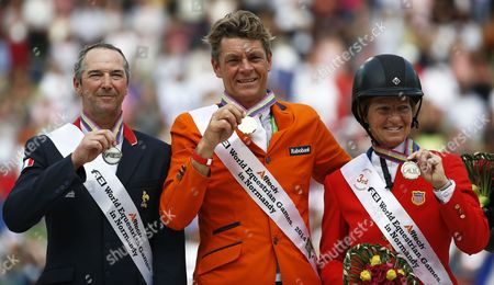 Stock Photo of Dutch Rider Jeroen Dubbeldam (c) Poses with His Gold Medal on the Podium After Winning the Jumping Final Four Competition at the World Equestrian Games 2014 in Caen France 07 September 2014 Dubbeldam Won Ahead of Second Placed French Rider Patrice Delaveau (l) and Third Placed Us Rider Beezie Madden (r) France Caen