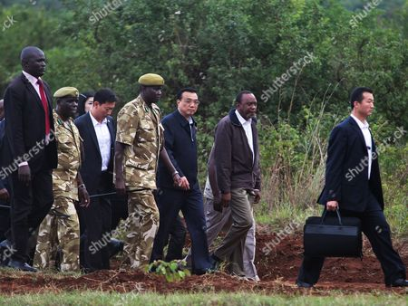 Kenya Wildlife Services (kws) Chairman William Kiprono (c-l) Chinese Prime Minister Li Keqiang (c) Kenyan President Uhuru Kenyatta (c-r) and Their Delegations Arrive For a Joint News Conference at the Ivory Burning Site of the Nairobi National Park in Nairobi Kenya 10 May 2014 Others Are not Identified the Leaders of the Two Countries Said That They Will Tighten Ties to Boost Trade Infrastructure Agriculture and Wildlife Conservation Prime Minister Li Keqiang During the Visit to the Site where Kenya Burns Ivory Recovered From Pochers Annouced Officially That China Will Grant the Kenyan Government Ten Million Dollars For Its Wildlife Conservation and to Enable Them to Fight the Illegal Ivory Trade Kenya Nairobi