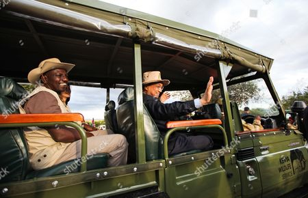 Kenyan Deputy President William Ruto (l) and Chinese Prime Minister Li Keqiang (c) Sit in a Jeep to Leave For a Tour After a Joint News Conference with Kenyan President Uhuru Kenyatta (not in Picture) at the Ivory Burning Site of the Nairobi National Park in Nairobi Kenya 10 May 2014 the Leaders of the Two Countries Said That They Will Tighten Ties to Boost Trade Infrastructure Agriculture and Wildlife Conservation Prime Minister Li Keqiang During the Visit to the Site where Kenya Burns Ivory Recovered From Pochers Annouced Officially That China Will Grant the Kenyan Government Ten Million Dollars For Its Wildlife Conservation and to Enable Them to Fight the Illegal Ivory Trade Kenya Nairobi