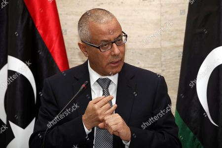 Libyan Prime Minister Ali Zeidan Speaks During a Press Conference in Tripoli Libya on 08 March 2014 Federalists in Eastern Libya Said 08 March That They Have Started to Export Oil Independently of the Central Government Escalating Their Stand-off with Tripoli Rebels Have Been Blocking the Oil Ports in Eastern Libya Since July Siding with Federalists Calling For Autonomy For the Eastern Region of Barqa Or Cyrenaica who Demand That Oil Revenues Be Assigned to the Area Pro-autonomy Rebels Held a Ceremony to Celebrate Their First Oil Shipment the Government's National Oil Company Said a Ship Flying the North Korean Flag Docked in the Port of Sidra Protected by Armed Groups who Control the Area Prime Minister Ali Zeidan in a Press Conference Threatened to Strike Any Ship Carrying Oil From Eastern Libya Libyan Arab Jamahiriya Tripoli