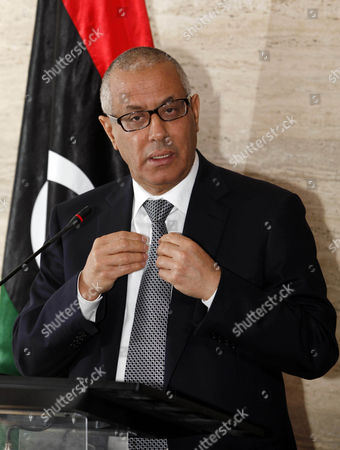Stock Photo of Libyan Prime Minister Ali Zeidan Speaks During a Press Conference in Tripoli Libya on 08 March 2014 Federalists in Eastern Libya Said 08 March That They Have Started to Export Oil Independently of the Central Government Escalating Their Stand-off with Tripoli Rebels Have Been Blocking the Oil Ports in Eastern Libya Since July Siding with Federalists Calling For Autonomy For the Eastern Region of Barqa Or Cyrenaica who Demand That Oil Revenues Be Assigned to the Area Pro-autonomy Rebels Held a Ceremony to Celebrate Their First Oil Shipment the Government's National Oil Company Said a Ship Flying the North Korean Flag Docked in the Port of Sidra Protected by Armed Groups who Control the Area Prime Minister Ali Zeidan in a Press Conference Threatened to Strike Any Ship Carrying Oil From Eastern Libya Libyan Arab Jamahiriya Tripoli
