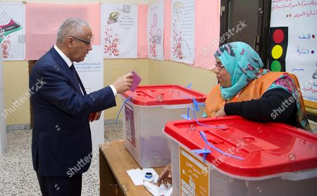 Stock Image of Former Libyan Prime Minister Ali Zeidan Casts His Ballot in Parliamentary Elections at a Polling Station in Tripoli Libya 25 June 2014 Voting in Libya's Parliamentary Elections was Reported to Be Proceeding Smoothly After Weeks of Armed Clashes in the East Between Islamist Militias and Forces Loyal to a Retired General Some 1 5 Million Voters of a Population of 6 Million Are Registered to Cast Ballots For 200 Members of a Successor Assembly to the General National Congress the Interim Parliament Elected in 2012 Libyan Arab Jamahiriya Tripoli