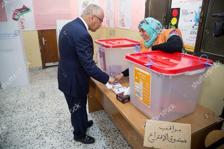 Stock Picture of Former Libyan Prime Minister Ali Zeidan Dips His Finger in Ink After Casting His Ballot in Parliamentary Elections at a Polling Station in Tripoli Libya 25 June 2014 Voting in Libya's Parliamentary Elections was Reported to Be Proceeding Smoothly After Weeks of Armed Clashes in the East Between Islamist Militias and Forces Loyal to a Retired General Some 1 5 Million Voters of a Population of 6 Million Are Registered to Cast Ballots For 200 Members of a Successor Assembly to the General National Congress the Interim Parliament Elected in 2012 Libyan Arab Jamahiriya Tripoli