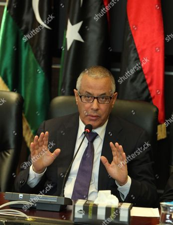 Libyan Prime Minister Ali Zeidan Speaks at a Press Conference with Members of the Government in Tripoli Libya 16 November 2013 the Briefing is Focused on Latest Situation in Tripoli at Least 27 People Were Killed and More Than 235 Injured when Gunmen Opened Fire on 15 November 2013 in Tripoli on Protestors who Were Demanding an End to the Presence of Armed Militias in the Libyan Capital Media Reports State Libyan Arab Jamahiriya Tripoli