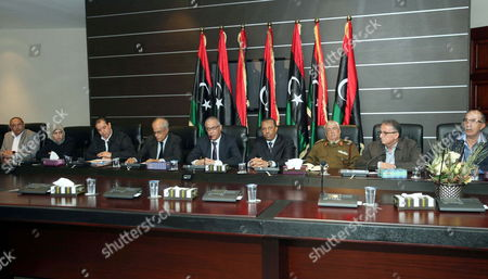 Libyan Prime Minister Ali Zeidan (c) Speaks at a Press Coference with Members of the Government in Tripoli Libya 16 November 2013 the Briefing is Focused on Latest Situation in Tripoli at Least 27 People Were Killed and More Than 235 Injured when Gunmen Opened Fire on 15 November 2013 in Tripoli on Protestors who Were Demanding an End to the Presence of Armed Militias in the Libyan Capital Media Reports State Libyan Arab Jamahiriya Tripoli