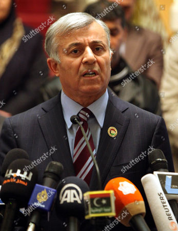 Nuri Abu Sahmain the Chairman of the Libyan General National Congress is Watched by Unidentified Members of the Libyan Interim Parliament As He Speaks to Journalists During a Media Conference on the Situation in the Country in Tripoli Libya 12 March 2014 the National Congress Voted Late 12 March to Replace Former Libyan Premier Ali Zeidan who Reportedly Defied a Travel Ban and Left the Country After His Government Failed to Prevent Rebels in Eastern Libya From Shipping Crude Oil out of the Country on a North Korean-flagged Tanker the National Congress the Same Day Appointed Defence Minister Abdullah Al-thini As Caretaker Premier For 15 Days Libyan Arab Jamahiriya Tripoli