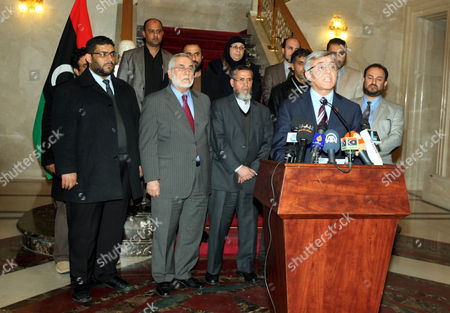 Nuri Abu Sahmain (front) the Chairman of the Libyan General National Congress is Watched by Unidentified Members of the Libyan Interim Parliament As He Speaks to Journalists During a Media Conference on the Situation in the Country in Tripoli Libya 12 March 2014 the National Congress Voted Late 12 March to Replace Former Libyan Premier Ali Zeidan who Reportedly Defied a Travel Ban and Left the Country After His Government Failed to Prevent Rebels in Eastern Libya From Shipping Crude Oil out of the Country on a North Korean-flagged Tanker the National Congress the Same Day Appointed Defence Minister Abdullah Al-thini As Caretaker Premier For 15 Days Libyan Arab Jamahiriya Tripoli