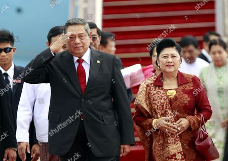 Stock Photo of Indonesia President Susilo Bambang Yudhoyono (l) and His Wife Ani Bambang Yudhoyono (r) As They Arrive at Naypyitaw International Airport to Attend the Association of Southeast Asian Nations (asean) Summit in Naypyitaw 10 May 2014 Myanmar Hosts the 24th Asean Summit in Naypyitaw As the First Time Since Its Join the Asean Community in 1997 and Theme For Its Chairmanship of Asean is 'Moving Forward in Unity to a Peaceful and Prosperous Community ' Myanmar Yangon