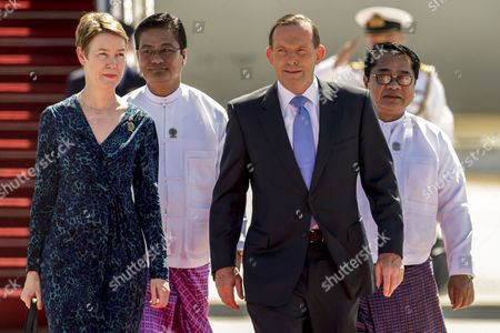 Stock Picture of Australian Prime Minister Tony Abbot (c) and His Wife Margaret Aitken (l) Arrive at the Naypyitaw International Airport For the 25th Association of South East Asian Nations (asean) Summit in the Administrative Capital of Naypyitaw Myanmar 12 November 2014 the Summit Runs From 09-13 November with Leaders From Ten Asean Member Countries and Its Dialogue Partners As Well As a Meeting of the East Asia Summit (eas) Involving Us President Barack Obama New Indonesian President Joko Widodo and Chinese Prime Minister Li Keqiang Among Others Myanmar Naypyitaw
